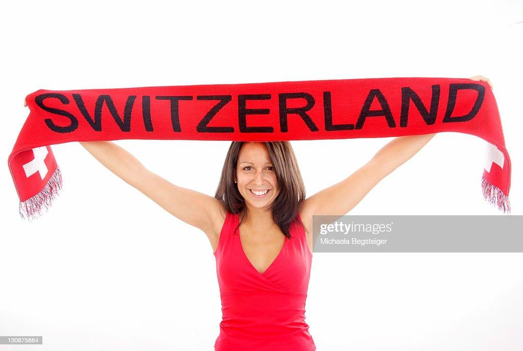 Swiss fan, woman with fan scarf : Foto de stock