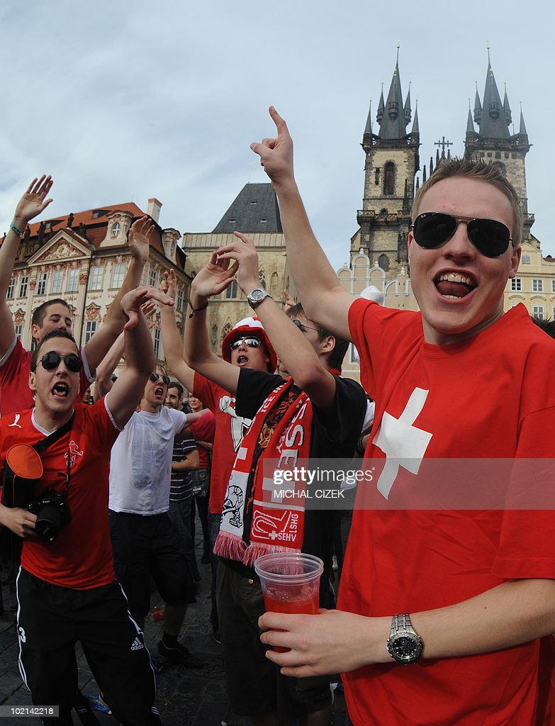 Swiss fans celebrate the victory of their National football team during the screening of Group H's first round 2010 World Cup football match Switzerland vs Spain held in South Africa, at the Old Town Square on June 16, 2010 in Prague. Switzerland defeated Spain1-0. PHOTO