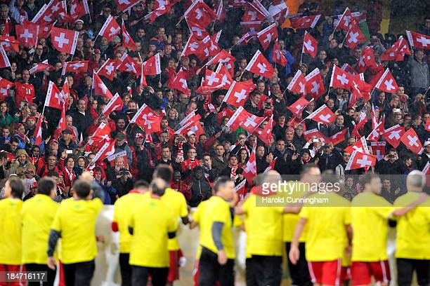 Swiss fans cheer during the FIFA 2014 World Cup Qualifier match between Switzerland and Slovenia match held at Stade de Suisse on October 15 2013 in...