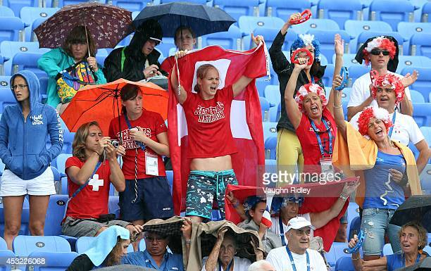 Swiss fans cheers during the Women's 200m Freestyle at Parc JeanDrapeau during the 15th FINA World Masters Championships on August 05 2014 in...