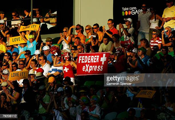 Swiss fans show their support during the semifinal match between Roger Federer of Switzerland and Novak Djokovic of Serbia on day twelve of the...