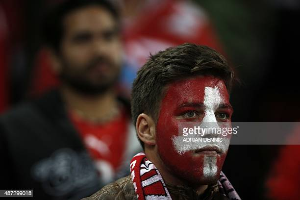 Swiss fans watch their team play during the Euro 2016 qualifying group E football match between England and Switzerland at Wembley Stadium in west...