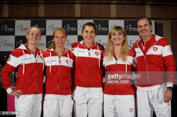 Swiss Fed Cup team members Jil Teichmann Viktorija Golubic Belinda Bencic Timea Bacsinsky and captain Heinz Gunthardt pose after the International...