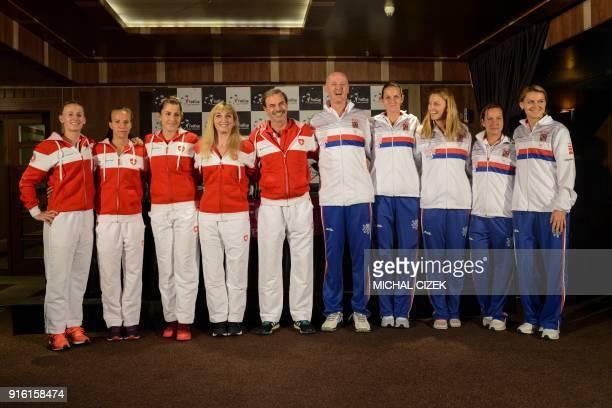 Swiss Fed Cup team players Jil Teichmann Viktorija Golubic Belinda Bencic Timea Bacsinszky and team captain Heinz Guenthardt pose next to Czech team...