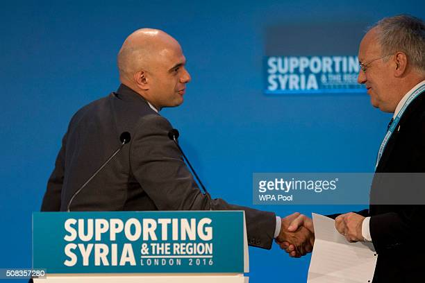 Swiss Federal President Johann SchneiderAmmann is welcomed on stage to make a pledge by British Business Secretary Sajid Javid during the second...