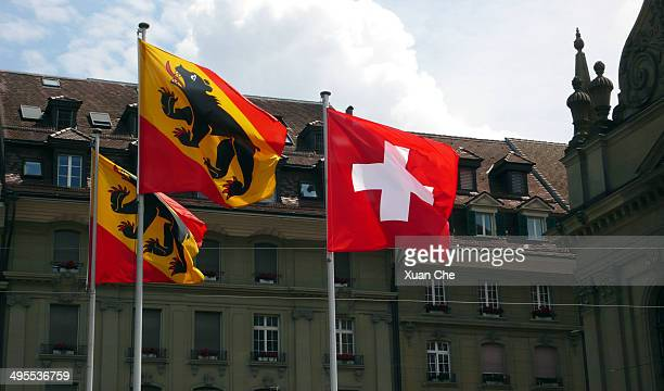 swiss federation and canton of bern flags - xuan che stock pictures, royalty-free photos & images