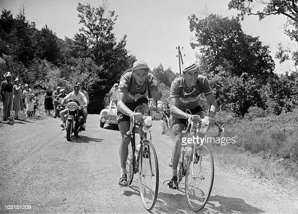 Swiss Ferdi Kubler and French Raphaël Geminiani ride during the 11th stage MarseilleAvignon of the Tour de France 1955 on July 18 1955