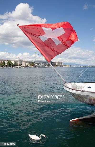 Swiss flag and swan on Lake Geneva