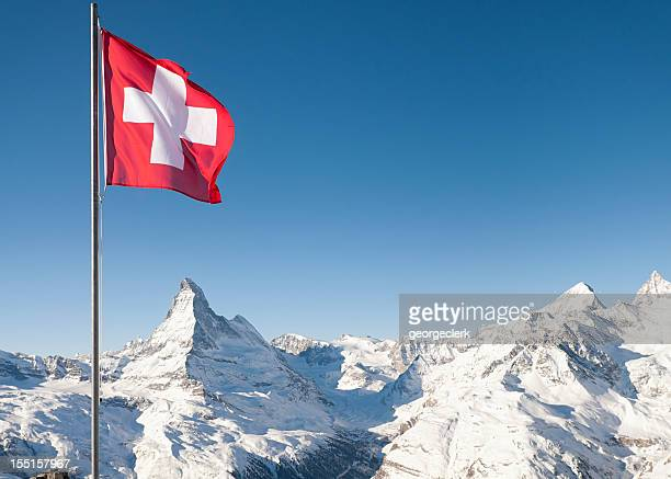 swiss flag and the matterhorn - switzerland stock pictures, royalty-free photos & images