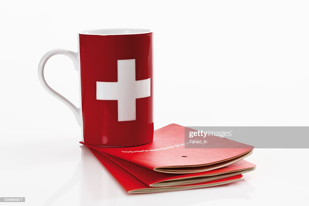 Swiss  flag cups with bank book on white background : Stock Photo