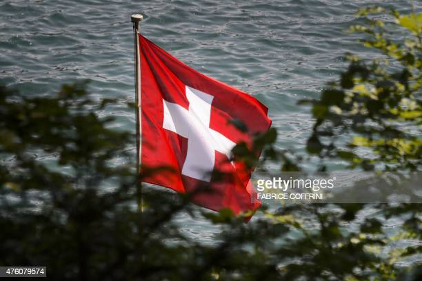 A Swiss flag float on June 5 2015 above Lake Lucerne in Rutli meadow considered as the birthplace of Switzerland According to the legend it was in...