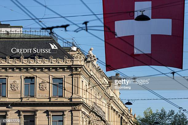 A Swiss flag hangs beyond Credit Suisse Group AG's headquarters in Zurich Switzerland on Friday April 24 2015 Investors are betting Chief Executive...