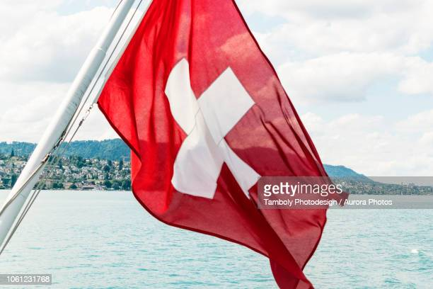 swiss flag on boat, zurich, switzerland - zurich stock pictures, royalty-free photos & images