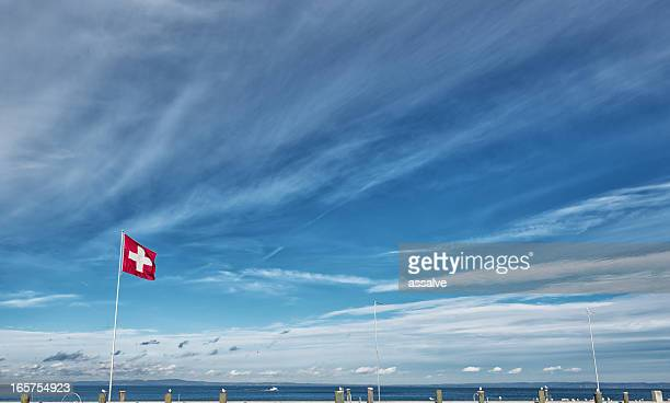 swiss flag over lake constance at harbour Rorschach