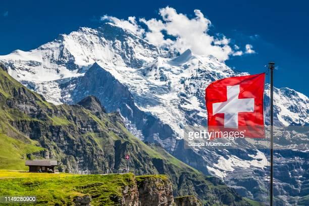 swiss flag, the männlichen and jungfrau - スイス文化 ストックフォトと画像