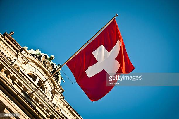 swiss flag waving on historic building - switzerland stock pictures, royalty-free photos & images