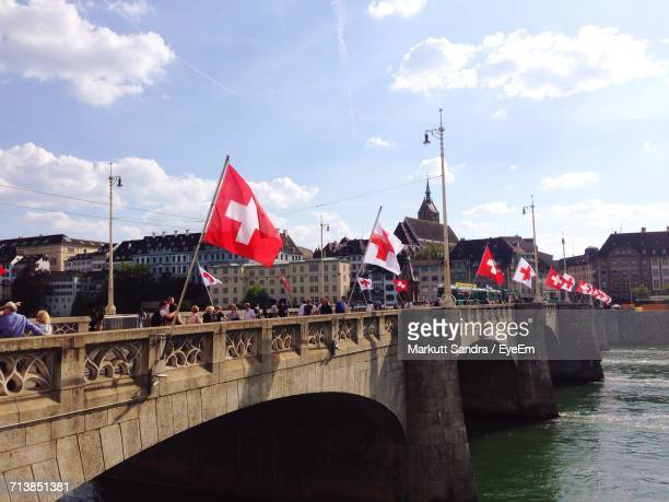 swiss flags on bridge over river - basel switzerland stock pictures, royalty-free photos & images