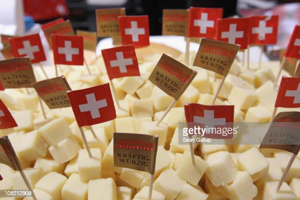 Swiss flags stick out of cubes ofAppenzeller Swiss cheese at a stand at the 2011 Gruene Woche agricultural trade fair at Messe Berlin on January 21...