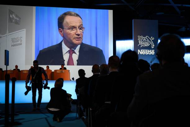 Swiss food giant Nestle CEO Ulf Mark Schneider appears on a giant screen as he addresses the group's annual general shareholders meeting on April 11,...