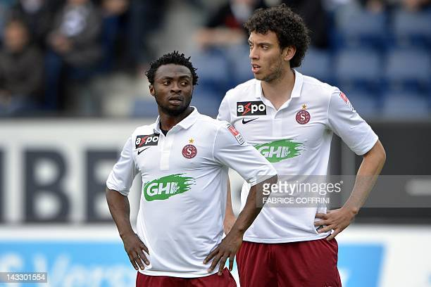 Swiss football club FC Servette players Laglais Kouassi and Roderick Miranda look on during the Swiss Super League match against FC Luzern on April...