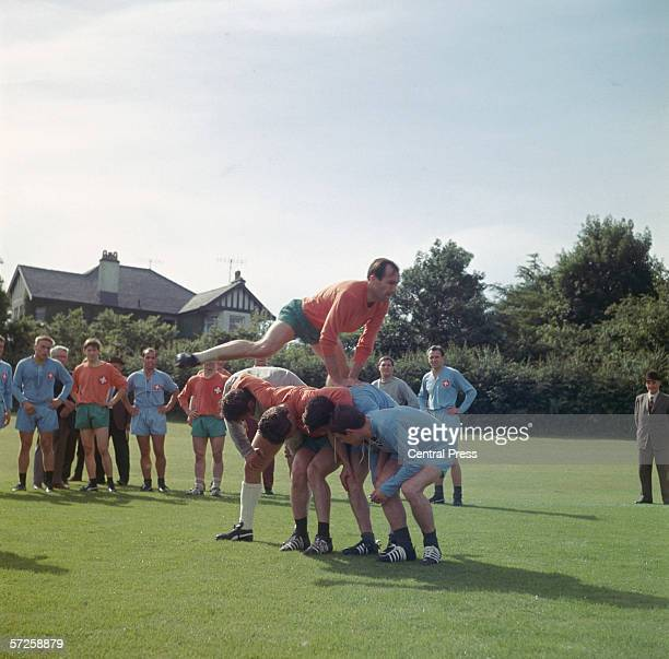 Swiss footballer Rene Brodman leapfrogging his team mates at a training session session at Sheffield University during the 1966 World Cup in England...
