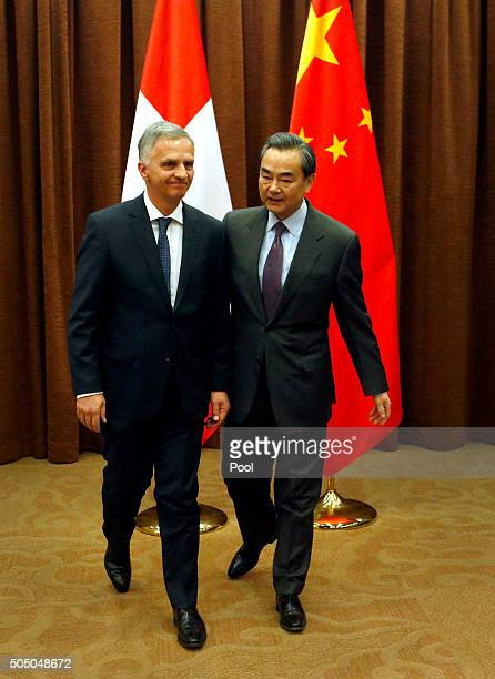 Swiss Foreign Minister Didier Burkhalter left and Chinese Foreign Minister Wang Yi right walk together before a bilateral meeting at the Ministry of...