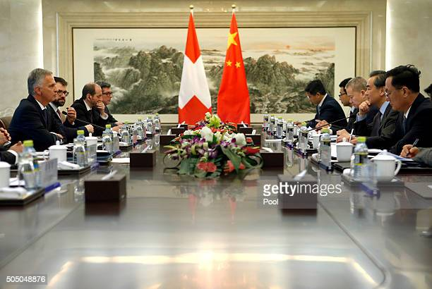 Swiss Foreign Minister Didier Burkhalter left speaks as Chinese Foreign Minister Wang Yi second from right listens during a bilateral meeting at the...