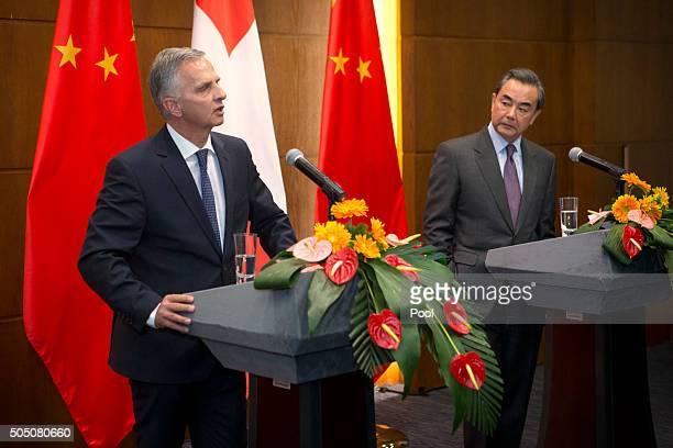 Swiss Foreign Minister Didier Burkhalter left speaks as Chinese Foreign Minister Wang Yi right listens during a joint press conference at the...