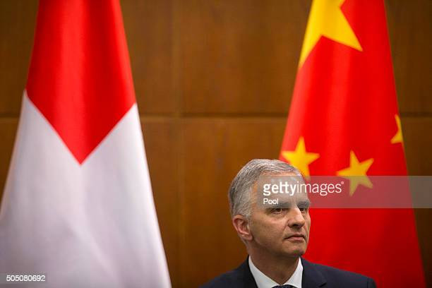 Swiss Foreign Minister Didier Burkhalter speaks during a joint press conference with Chinese Foreign Minister Wang Yi not shown at the Ministry of...