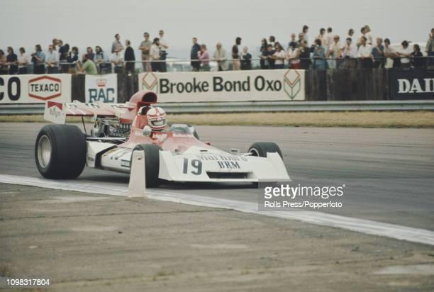 Swiss Formula One racing driver Clay Regazzoni drives the Marlboro BRM BRM P160E BRM P142 V12 to finish in 7th place in the 1973 British Grand Prix...