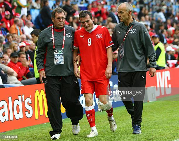 Swiss forward Alexander Frei leaves the field helped by a medical worker after being injured during the Euro 2008 Championships Group A football...