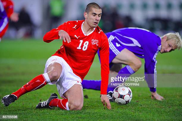 Swiss forward Eren Derdiyok vies for the ball with Finnish defender Sami Hyypia during a friendly football match at the AFG Arena on November 19 in...