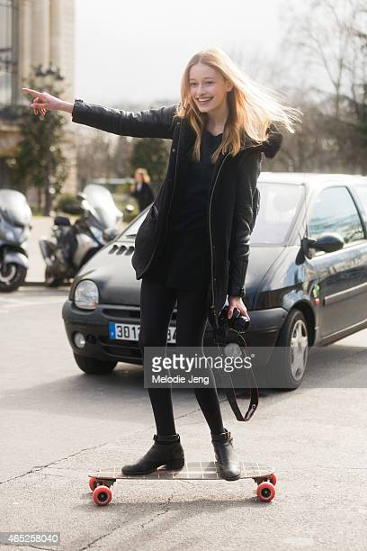 Swiss French model Jade de Lavareille exits the Guy Laroche show in a skateboard on March 4 2015 in Paris France