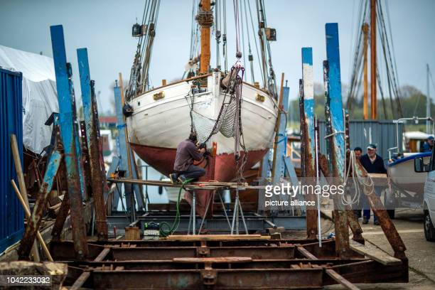 Swiss Gaspard Barraud from Montreux is woking on his salmon cutter Omi Alma from 1928 at the wharf on Poel Island in KirchdorfGermany 06 May 2017 The...