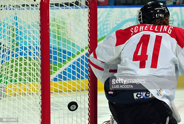Swiss goalie Florence Schelling watches the puck go past on a Canada goal during the Women's Ice Hockey preliminary game between Switzerland and...