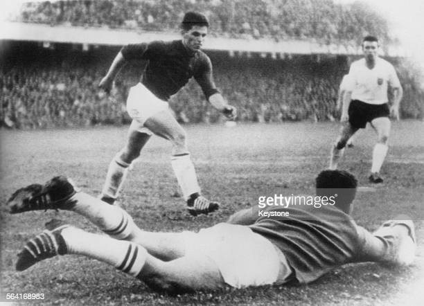 Swiss goalkeeper Kurt Stettler saves a shot from Jimmy Greaves of England during a friendly international at Sankt Jakob Stadium Basel Switzerland...