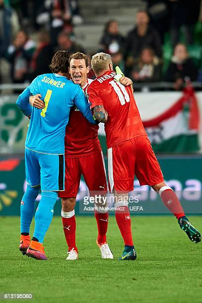 Swiss goalkeeper Yann Sommer and Stephan Lichtsteiner and Valon Behrami celebrate after wining game during the 2018 FIFA World Cup Qualifiers soccer...