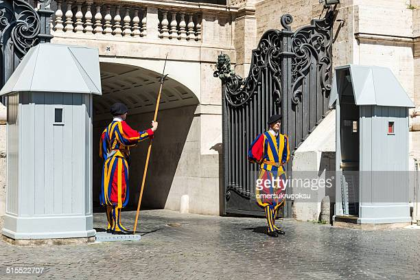 swiss guard stands at an entrance of the vatican - halberd stock pictures, royalty-free photos & images