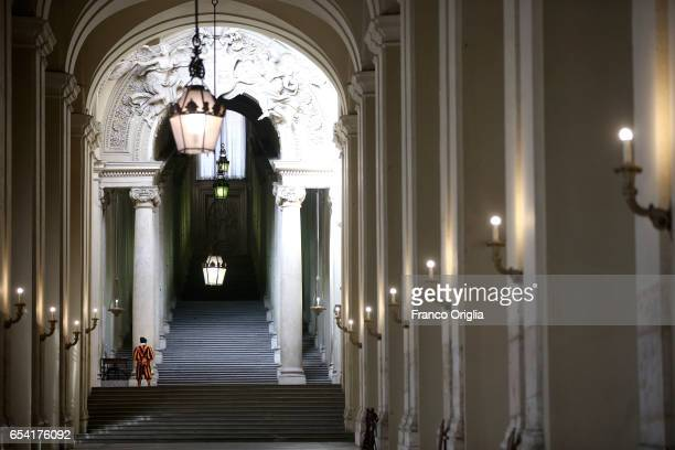 Swiss guard stands at the Braccio di Calo Magno of the Apostolic Palace on March 16 2017 in Vatican City Vatican The Apostolic Palace is the official...
