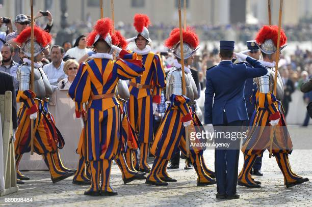 Swiss guards are seen Thousands of people gather to listen Pope Francis speech of traditional 'Urbi et Orbi' Blessing to the City of Rome and to the...