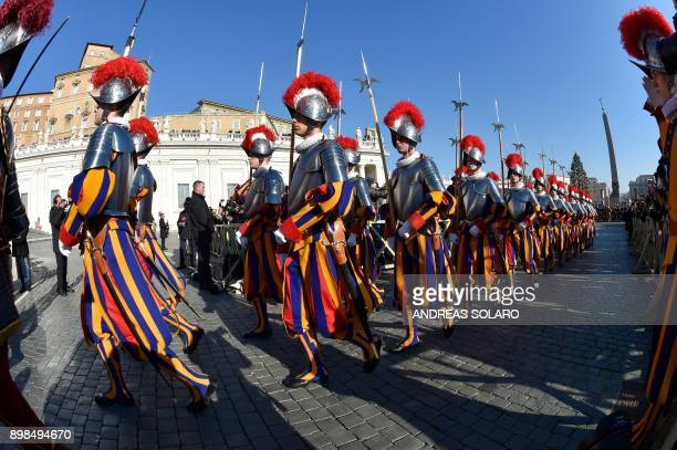 TOPSHOT Swiss guards arrive to take position before the traditional Urbi et Orbi Christmas address and blessing given to the city of Rome and to the...