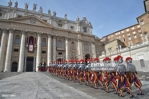 TOPSHOT Swiss guards parade before the arrival of the Pope for the traditional Urbi et Orbi Christmas message to the city and the world on December...