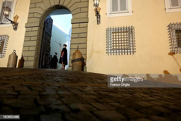 Swiss Guards prepare to close the gate of the Apostolic Palace after Pope Benedict XVI greeted the pilgrims for the last time as head of the Catholic...