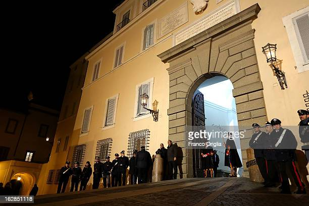 Swiss Guards prepare to close the gate of the Apostolic Palace closes after Pope Benedict XVI greeted the pilgrims for the last time as head of the...