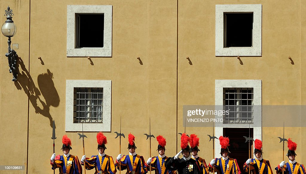 Swiss guards stand in the San Damaso court at the Vatican on May 21, 2010.