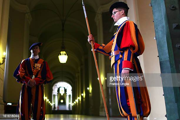 Swiss guards stand on attention at the Portone di Bronzo of the Apostolic Palace on October 29 2012 in Vatican City Vatican Pope Sixtus V built the...