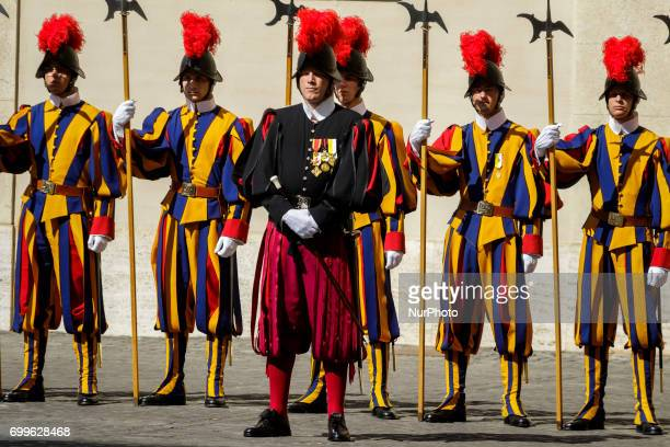 Swiss Guards stand on duty as King Willem Alexander and the Queen Maxima of the Netherlands arrive at the Apostolic Palace to attend a private...