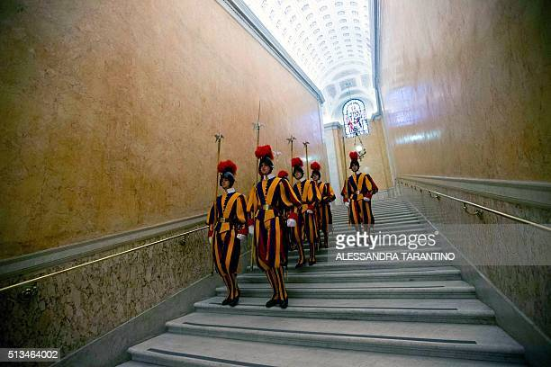 TOPSHOT Swiss Guards walk down a staircase in the Vatican after the private audience between the Prime Minister of East Timor Rui Maria de Araujo and...