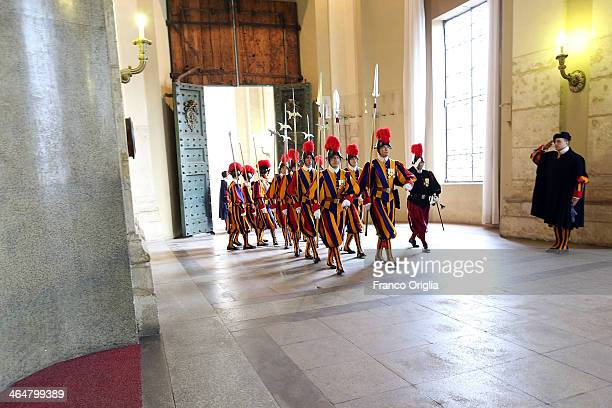 Swiss guards walks to the Cortile di San Damaso at the Apostolic Palace for the audience of Pope Francis to French President Francois Hollande on...