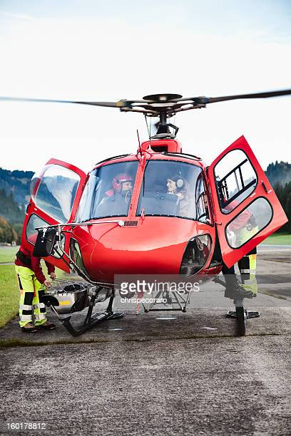 swiss helicopter transport readying for takeoff - medevac stock photos and pictures